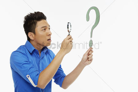 Magnifying glass : Man looking through a magnifying glass