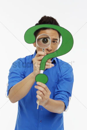 Masculinity : Man looking through a magnifying glass