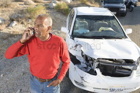 On the road : Man on mobile following car accident
