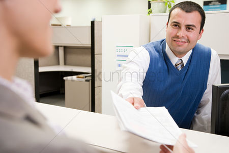 Interior : Man passing paper