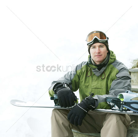 Jacket : Man posing with his snowboard