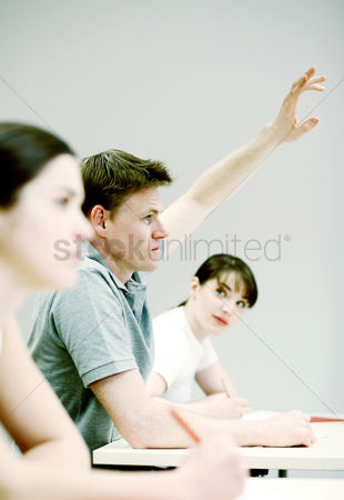 College : Man raising his hand to answer question