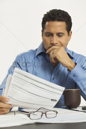 Worry : Man reading a tax form