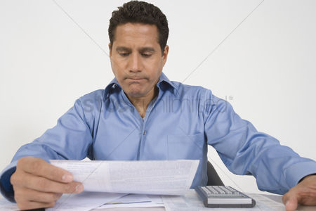 Worry : Man reading financial document