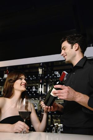 Wine bottle : Man recommending good wine to woman