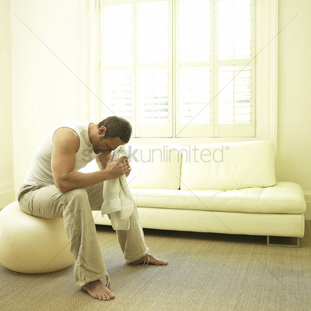 Thought : Man resting on fitness ball