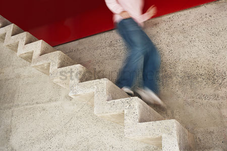 Steps : Man running down stairs motion blur low section