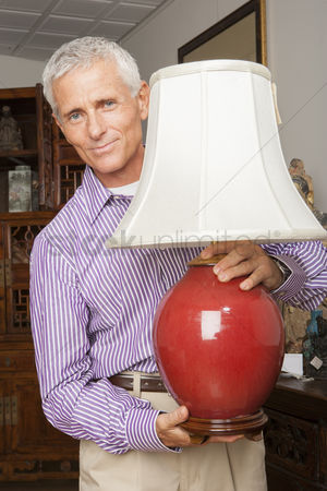 Collection : Man shopping for lamp antique in store