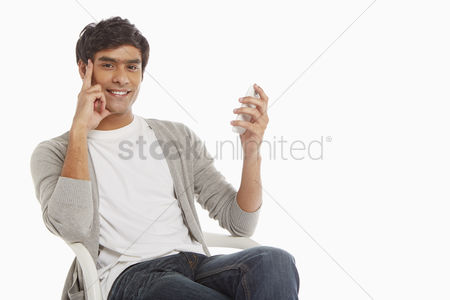 Portability : Man sitting on a chair  text messaging