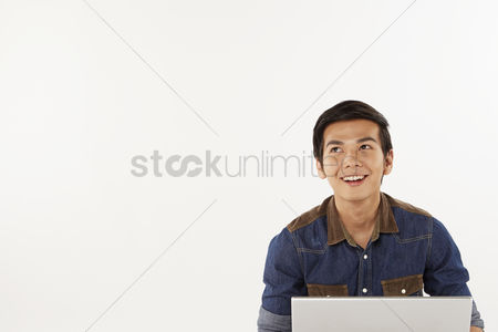 Portability : Man sitting on the floor  using laptop
