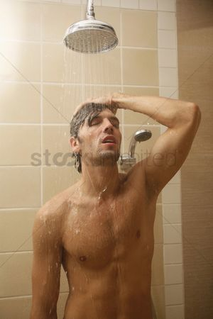Arm raised : Man taking a shower