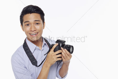 Hobby : Man taking pictures with a digital camera