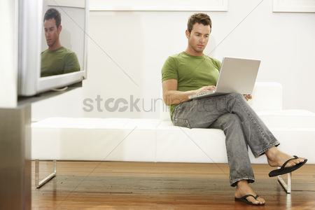 Posed : Man using laptop