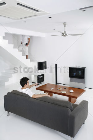 Tidy : Man watching television in the living room