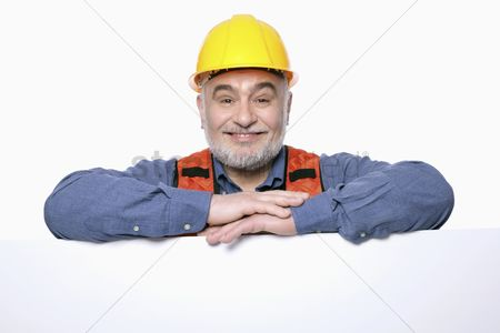 Head shot : Man with hardhat posing with placard