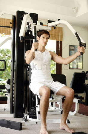 Strong : Man working out in the gym