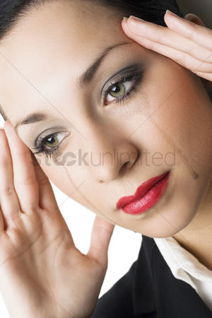 Worry : Mascara mixed tears flowing down woman s cheek