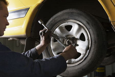 Car : Mechanic working on tire