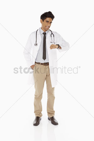 Medical personnel : Medical personnel checking his watch