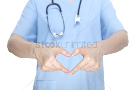 Medical personnel : Medical personnel forming a heart with hands