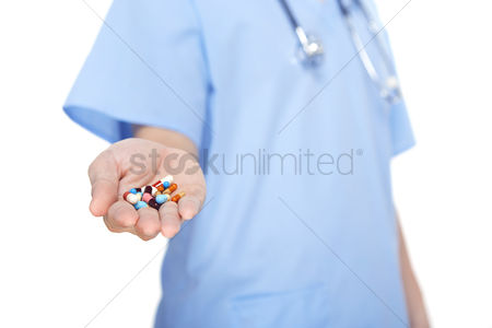 Medication : Medical personnel holding a bunch of pills