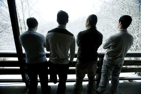 Cold : Men enjoying the view from chalet