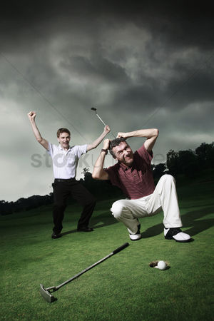Loss : Men playing golf at golf course