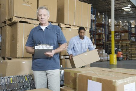 Notepad : Men working in distribution warehouse