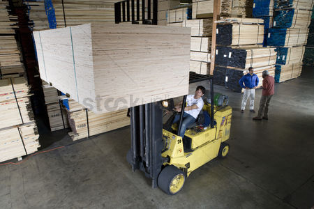 Forklift : Men working in warehouse