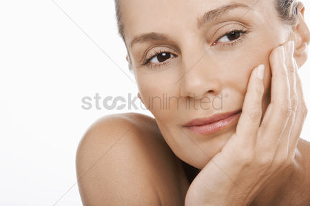 Posed : Middle-aged woman hand on chin