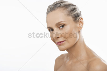Head shot : Middle-aged woman head tilted forward