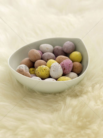 Easter : Mini eggs on sheepskin rug