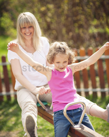 Czech republic : Mother and daughter ride seesaw together