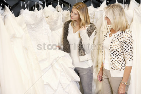 Offspring : Mother and daughter selecting bridal gown in boutique