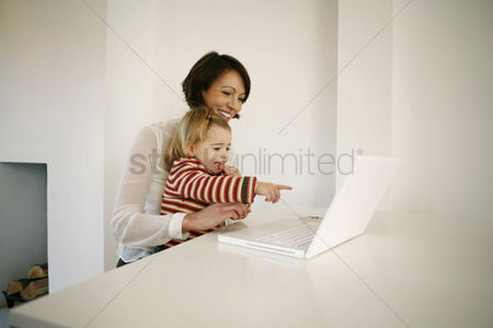 Children : Mother and daughter using laptop