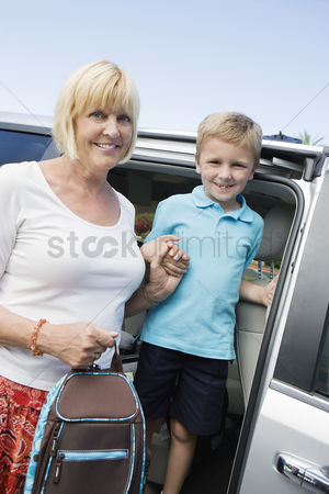 Schoolkids : Mother driving son to school