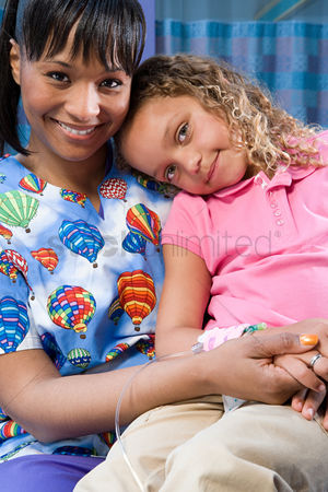 Sitting on lap : Nurse looking after girl