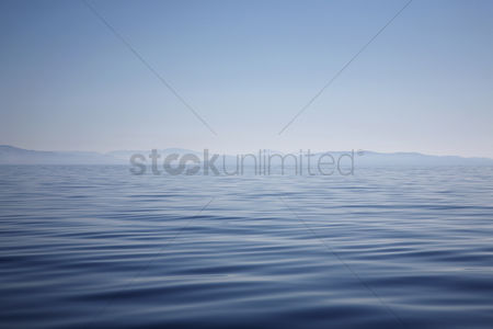 Land : Ocean with hazy mountain shore