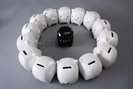 Sets : One black piggy banks surrounded by white piggy banks