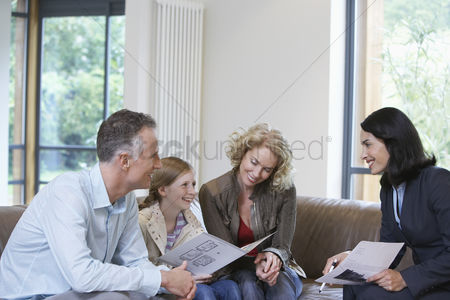 Daughter : Parents and daughter  7-9  with estate agent discussing new property