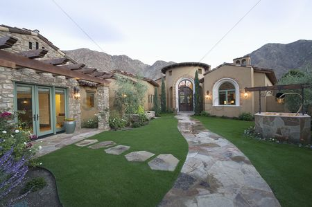 Grass : Paved pathway to palm springs home