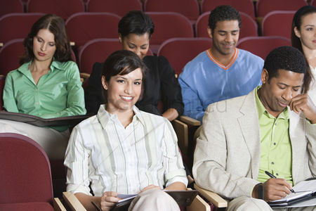 Arts : People sitting in auditorium and clapping hands