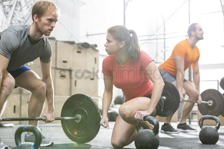 Sports : People weightlifting in crossfit gym