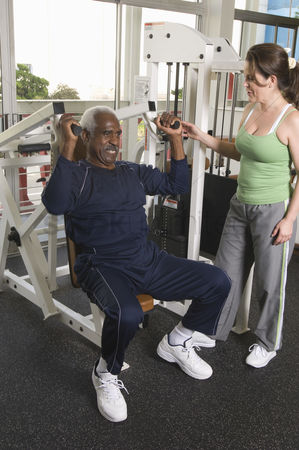 Workout : Personal trainer working with senior man