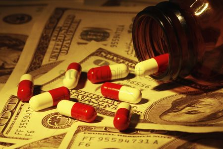 Us : Pill capsules on us paper currency