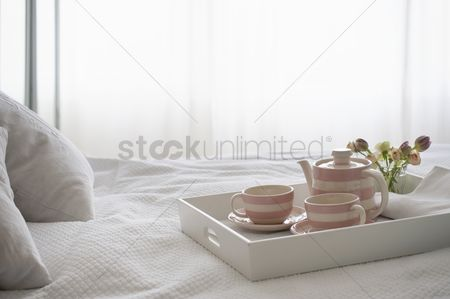 Interior : Pink striped teaset on breakfast tray