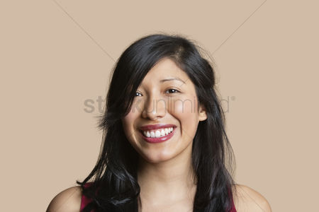 Black background : Portrait of a beautiful happy woman over colored background