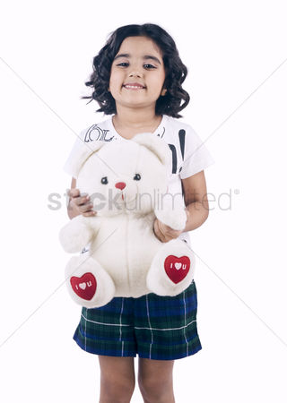 Satisfying : Portrait of a girl holding a teddy bear and smiling