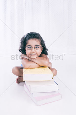 Bliss : Portrait of a girl leaning on books