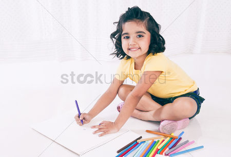 Bliss : Portrait of a girl making a drawing